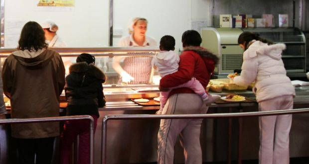 Asylum seekers queue in the canteen at Mosney Reception Centre. Photograph: Frank Miller