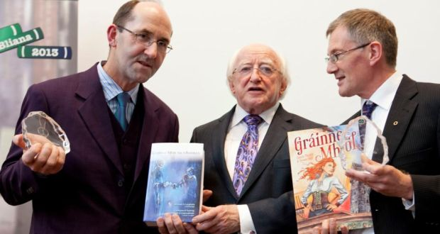 President Michael D Higgins with Micheál Ó Conghaile, one of the editors of Leabhar Mór na nAmhrán, and Colm Ó Raghallaigh, who published the graphic novel version of Gráinne Mhaol