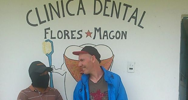 "Michael McCaughan and his ""votan"", or guadian, David, in front of the dental clinic in Moises Gandhi. Photograph: Sergio Chua"