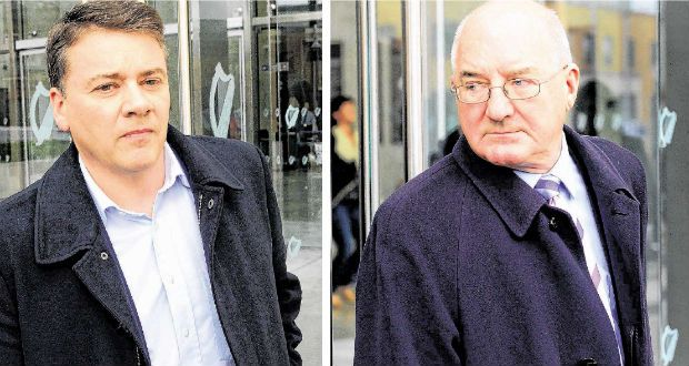 Pat Whelan, former director of Anglo Irish Bank, and Willie McAteer, former director of finance, leave Dublin Circuit Criminal Court after yesterday's guilty verdicts. Photograph: Eric Luke