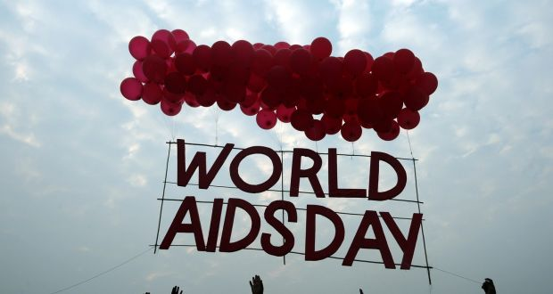 Indian social activists and children release a World Aids Day sign  tied balloons in Kolkata,  December 1st, 2015. According to the UN Aids programme, India had the third-largest number of people living with HIV in the world at the end of 2013.  Photograph: Dibyangshu Sarkar/AFP/Getty Images