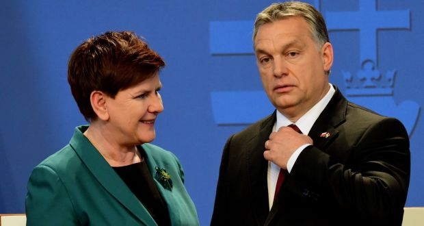 Poland's prime minister Beata Szydlo  and her Hungarian counterpart Viktor Orban  pose for photographers after their press conference in Budapest on Monday. Photograph: Attila Kisbenedek/AFP/Getty Images