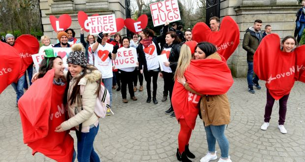 Hugs doled out to members of the public at the Members of the Action Against Racism demonstration in Dublin on Saturday. Photograph:  Cyril Byrne/The Irish Times
