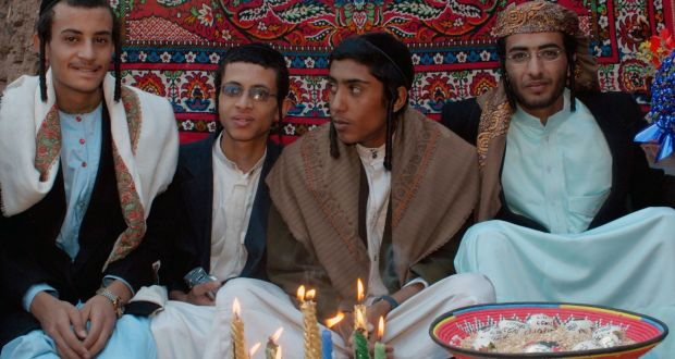 Yemeni Jews Yussef Saeed Hamdi (right), poses with unidentified guests on the first day of his traditional wedding party in the village of Raydah in Amran province, 70km north of Sanaa, in this 2008 photo. Photograph: Khaled Fazaa/AFP/Getty Images