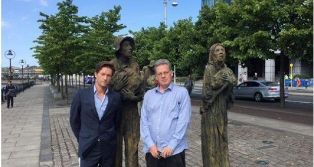 Michael Collins and Jason King beside Rowan Gillespie's Famine memorial in Dublin