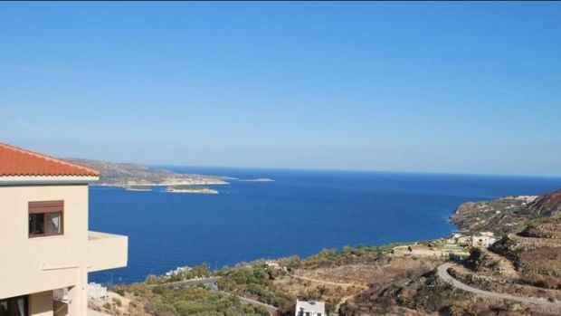 The 191sq m house in Crete is on a slope, giving it great views