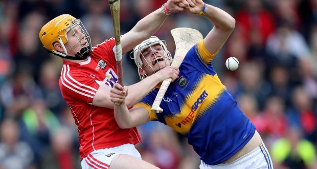 Cork's James Keating battles for possession with Anthony McKelvey of Tipperary during the Electric Ireland Munster MHC semi-final replay at Páirc Uí Rinn. Photograph: Bryan Keane/Inpho