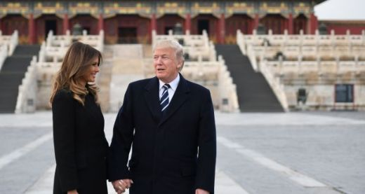 The Asia tour: US president Donald Trump and Melania in the Forbidden City in Beijing. Photograph: AFP/Getty Images