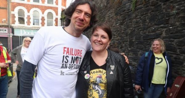 Lead singer of Snow Patrol Gary Lightbody with Sara Canning, partner of murdered journalist Lyra McKee at the end of their three-day peace walk from Belfast at the Guildhall in Derry, Northern Ireland. Photograph: Liam McBurney/PA Wire