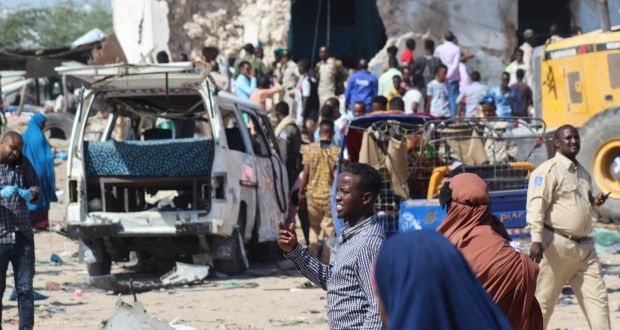 People gather at the scene of a large explosion near a check point in Mogadishu, Somalia, on Saturday. Photograph: EPA