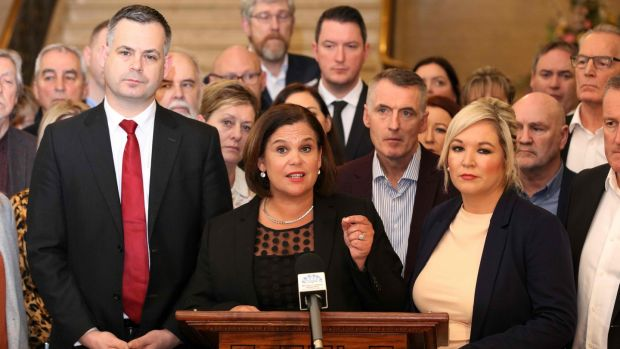 Sinn Fein party leader Mary Lou McDonald (C) speaks flanked by deputy leader Michelle O'Neill (R) and other colleagues at the Parliament Buildings on the Stormont Estate. Photograph: Paul Faith/AFP via Getty Images