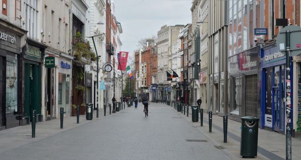 Dublin's Grafton Street devoid of people as Covid-19 coronavirus restrictions remain in place. Photograph: Alan Betson
