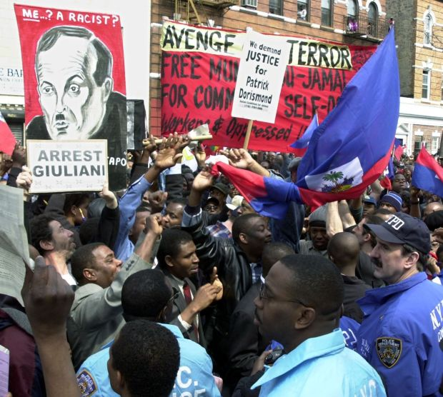 Protesters confront NYPD officers outside the funeral of Patrick Dorismond in March 2000. Photograph: Henny Ray Abrams/AFP via Getty