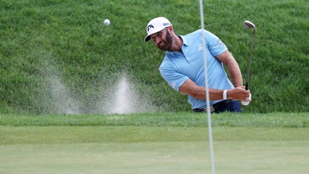 Dustin Johnson plays a shot from a bunker on the 16th hole during the final round of the Travelers Championship. Photograph: Rob Carr/Getty Images