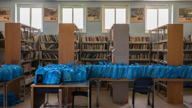 Books wrapped in plastic bags in Gymnasia Ha'ivrit high school's library in Jerusalem on July 30th. Photograph: Dan Balilty/New York Times