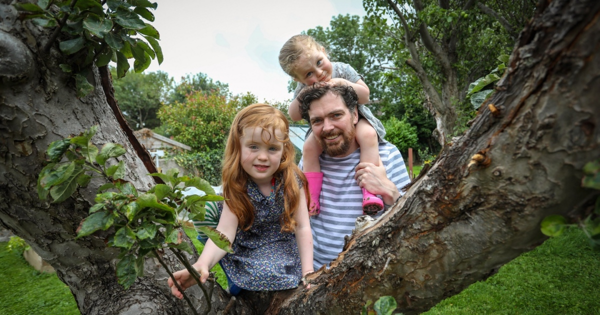 Adam Bermingham with his daughters Erica and Niamh at their home in Churchtown. Photograph: Crispin Rodwell/The Irish Times