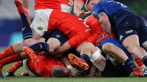 Chris Farrell is tackled as Andrew Porter looks to clear out during Leinster's win over Munster. Photograph: Billy Stickland/Inpho