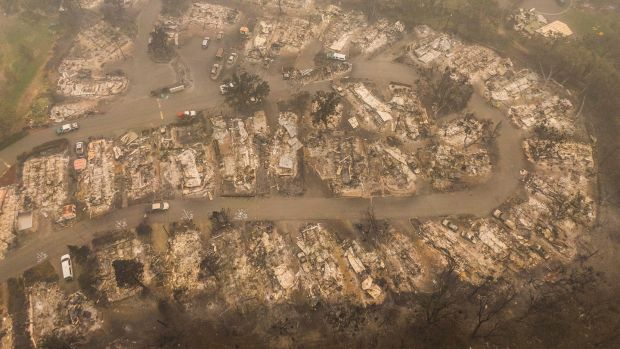 Damaged homes are seen in a mobile home park that was destroyed by wildfire in Ashland, Oregon. Photograph: David Ryder/Getty Images