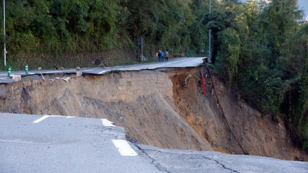 A collapsed road along the Vesubie river that was partially washed away after heavy rain from Storm Alex, in Roquebilliere, France, on Saturday. Continuous heavy rains and further wet weather are expected as storm Alex moves across southern France. Photograph: Sebastien Nogier/EPA