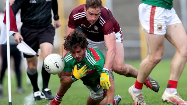 Mayo's Mark moran is tackled by Galway's Gary O'Donnell. Photograph: Bryan Keane/Inpho