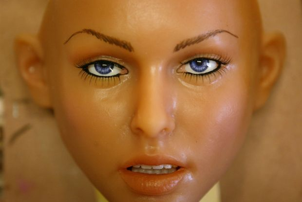 A silicone RealDoll sex doll face looks up from a workbench at the Abyss Creations factory in San Marcos, California. Photograph: David McNew/Getty Images
