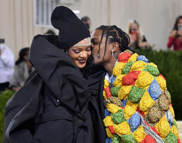 """Barbadian singer Rihanna and US rapper A$AP Rocky arrive for the 2021 Met Gala at the Metropolitan Museum of Art on September 13, 2021 in New York. - This year's Met Gala has a distinctively youthful imprint, hosted by singer Billie Eilish, actor Timothee Chalamet, poet Amanda Gorman and tennis star Naomi Osaka, none of them older than 25. The 2021 theme is """"In America: A Lexicon of Fashion."""" (Photo by ANGELA WEISS / AFP) (Photo by ANGELA WEISS/AFP via Getty Images)"""