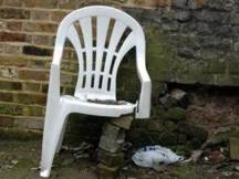 Broken white plastic chair