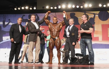 Bodybuilding Overall Winner-Lukas Wyler-left to right Shawn Ray, Arnold Schwarzenegger, Wyler, Dr. Rafael Santonja, Rich Gaspari