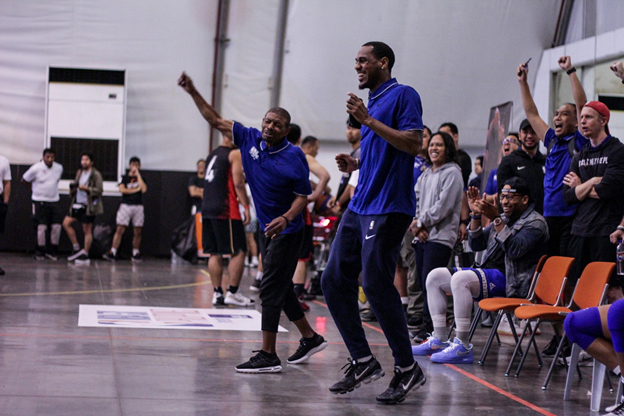 NBA Legend Muggsy Bogues and Denver Nuggets guard celebrates with the crowd as a Men's Open Division takes the game with a buzzer beater.