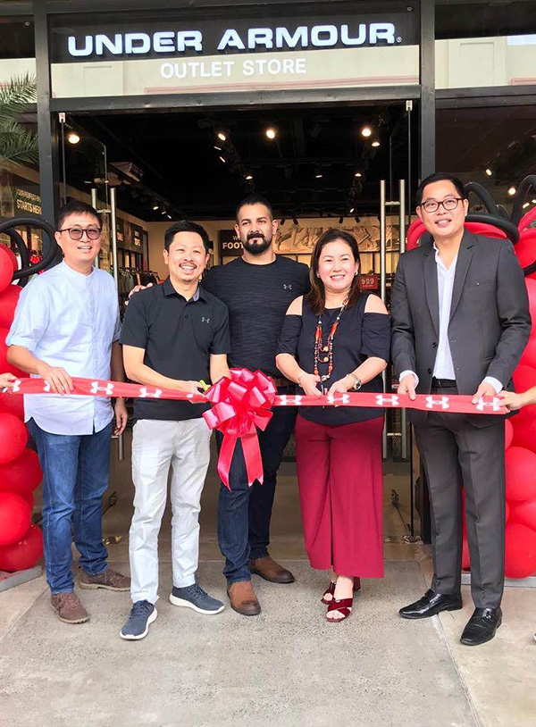 (L-R) Christopher Balonan, Cathay Land's Corporate Treasurer; Mark Chan, President of Walk EZ Retail Corp.; Jayden Lewis, Freeport Retail's Leasing Manager for Asia; Hon. Omil Poblete, former Mayor of Silang, Cavite; and Arman Ilano, Acienda's Center Manager did the honors of ribbon cutting – formally opening the Under Armour outlet store to the public.