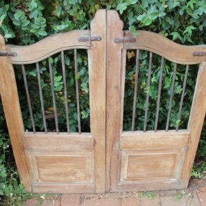 Garden gate with a timber frame and iron bars