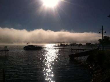 Sunrise with fog over lake 2015