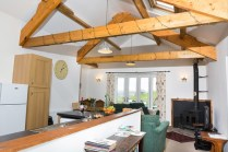 Exposed beams, wood burning stove, open plan