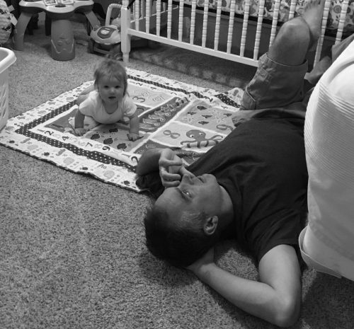 Hanging out on the floor with Dad talking on the phone.