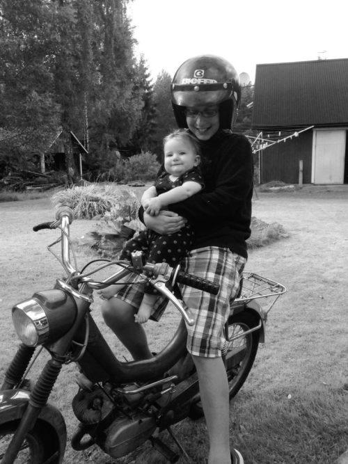 Ben and Izzy pretending to ride Dan's antique moped.