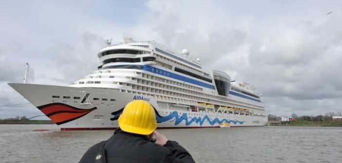 AIDAmar cruise ship leaves Papenburg wharf