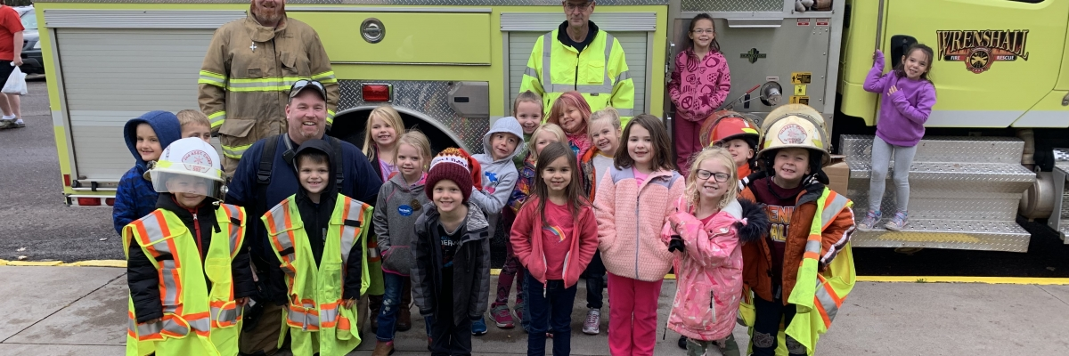 Kindergartners learn about firetrucks