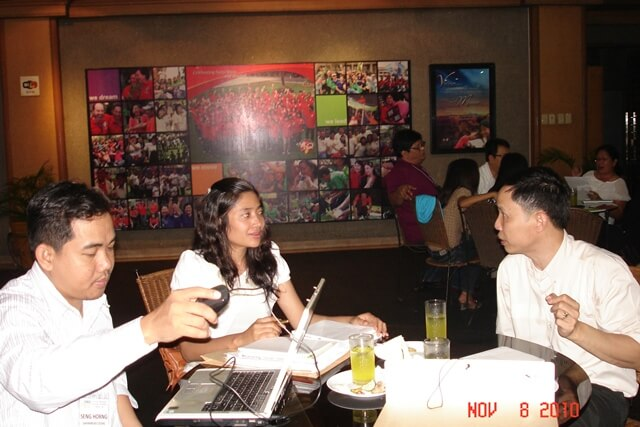 Kok Kao, Oikocredit-Cambodia Country Manager (right) and CEDAC Officers Lang Seng Horng (left) and Nou Socheat (center) discuss applications of concepts and tools learned to CEDAC and social enterprises in Cambodia.