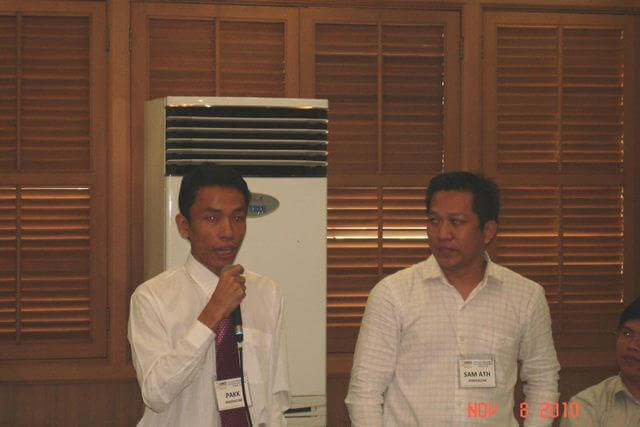 PERFEXCOM-Cambodia Officers Chhorn Sam Ath (right) and Yourng Pakk (left) share the results of their workshop to the plenary.