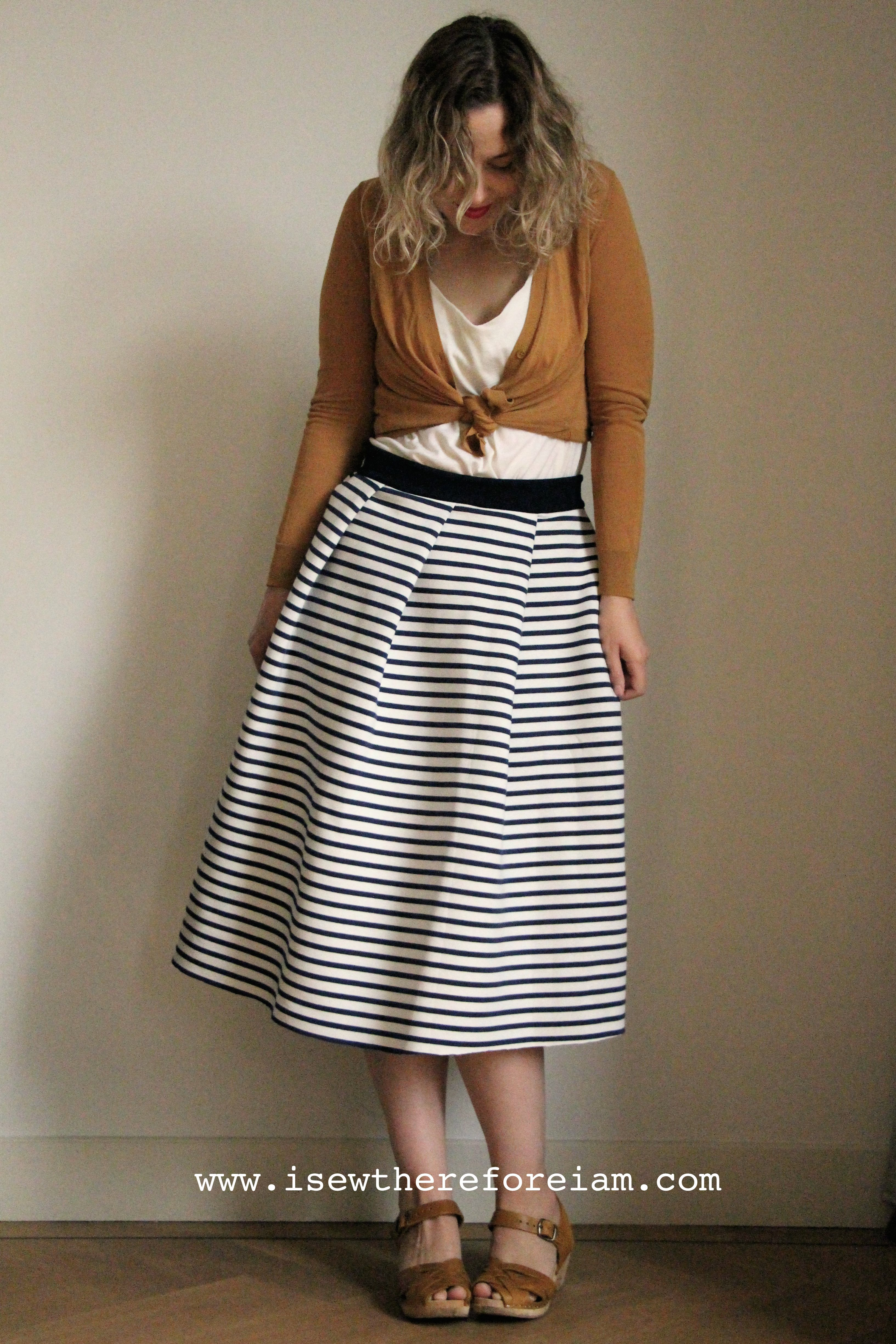 Striped pleated midi skirt made out of a reversible knit
