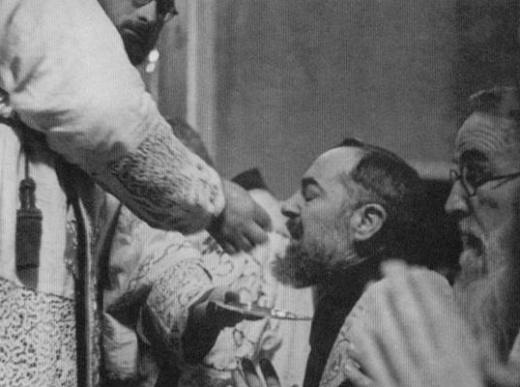 Padre Pio Receiving Communion