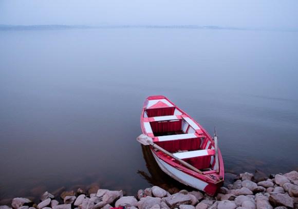 Boat parked on the edge of Rawal Lake at Lake View Park in Islamabad.
