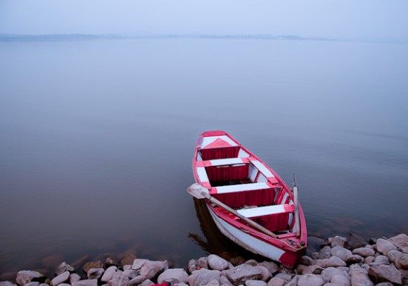 Boat parked on the edge of Rawal Lake at Lake View Park in Islamabad.