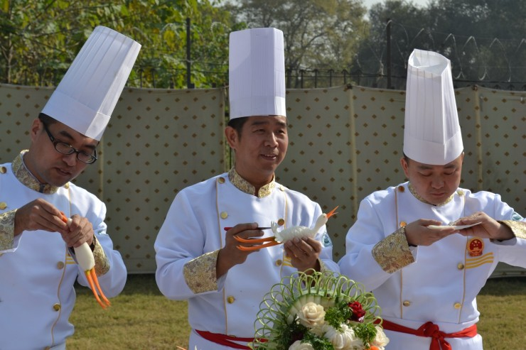 Chinese chefs presenting delicate food carving techniques at Lok Virsa in Islamabad