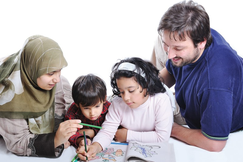Happy family with several members in education process