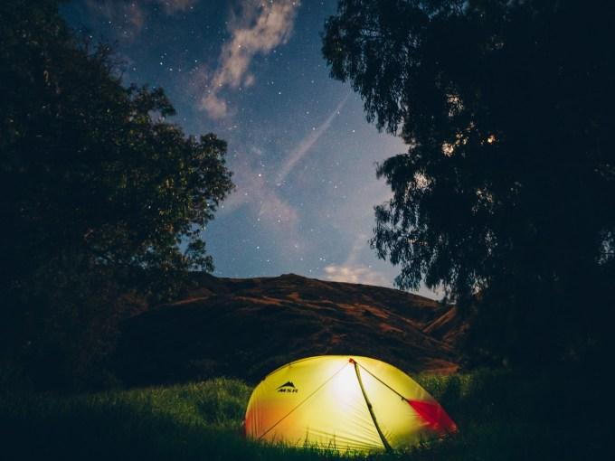 Tent under night sky on Santa Cruz Island