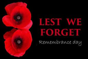 "Black Background with red poppies on left lside with the caption ""Lest We forget Remembrance Day"""