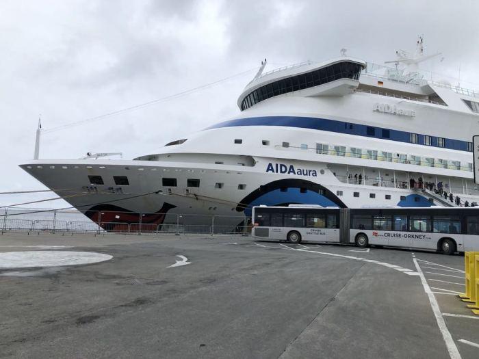 AIDAaura and Shuttle bus Hatston