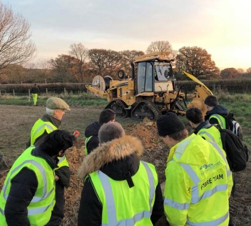 wessex internet fibre team in field tractor
