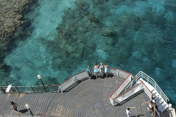Tourists enjoy a view of the Red Sea from the aquapark bridge at Coral Beach. Photo by Anna Kaplan/Flash90.